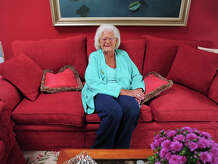 Dorothy Larson poses at her home in Easton, Conn., on Wednesday Sept. 24, 2014. Larson, a well know philanthropist in the area, will be honored at the Kennedy Center's 50th Four Seasons Ball on Saturday Oct. 25th in Wilton. The Kennedy Center, CT, helps people with disabilities.