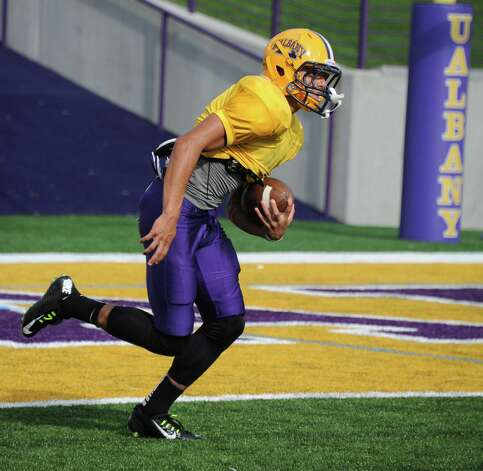 UAlbany freshman wide receiver Josh Gontarek runs with the ball after catching a punt during football practice on Wednesday, Sept. 24, 2014 in Albany, N.Y. (Lori Van Buren / Times Union) Photo: Lori Van Buren / 00028732A
