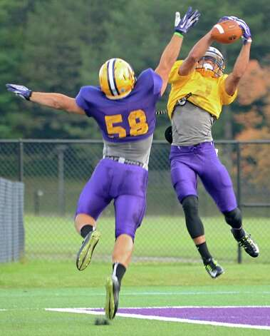 UAlbany freshman wide receiver Josh Gontarek, right, catches a pass near the end zone during football practice on Wednesday, Sept. 24, 2014 in Albany, N.Y. (Lori Van Buren / Times Union) Photo: Lori Van Buren / 00028732A