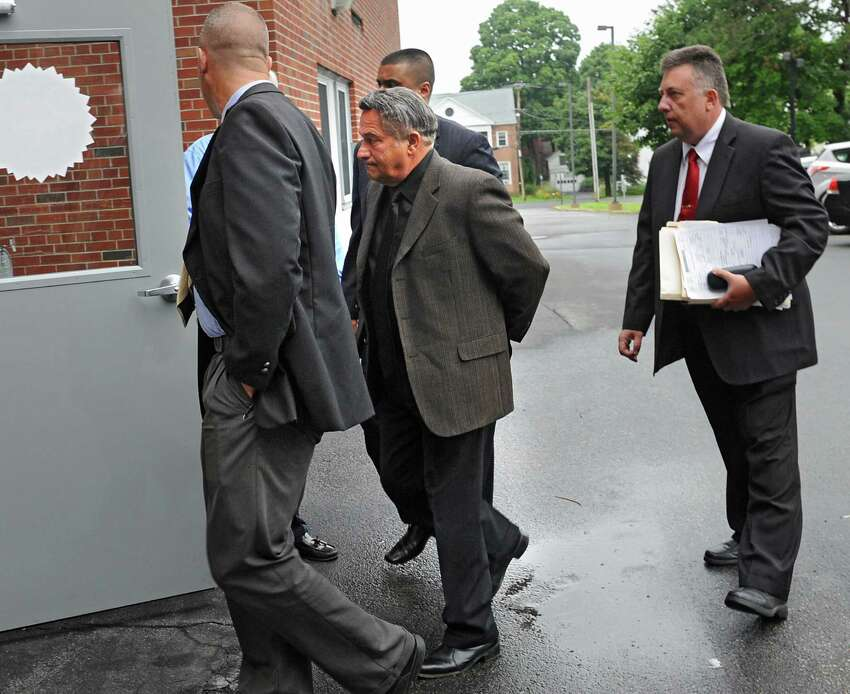 Bruce Tanski is brought to the Saratoga County Courthouse by FBI agents and state Attorney General investigators on Friday, Aug. 22, 2014 in Ballston Spa, N.Y. Tanski, a prominent Halfmoon builder, was arrested by State Police on charges alleging he paid employees and business associates to make political contributions to the campaign account of Melinda Wormuth, a former Halfmoon town supervisor. (Lori Van Buren / Times Union) ORG XMIT: MER2014082209152979