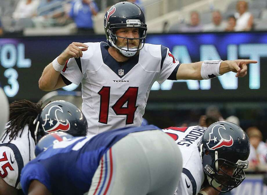 Texans quarterback Ryan Fitzpatrick said he's tried to convince his children to cheer for Houston rather than Buffalo this week. Photo: Kathy Willens / Associated Press / AP