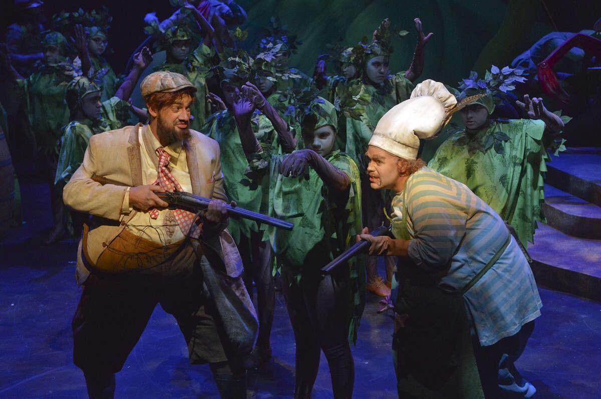 "Singers Andrew Craig Brown (left) and Edwin Vega hunt for foxes in Opera San Antonio's engaging ""Fantastic Mr. Fox."""