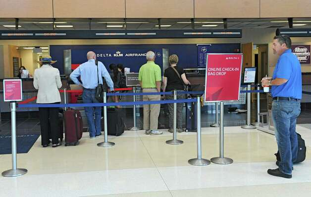 People wait in line to check in at the Delta ticket counter at the Albany International Airport on Wednesday, Sept. 24, 2014 in Colonie, N.Y. (Lori Van Buren / Times Union) Photo: Lori Van Buren / 10028742A