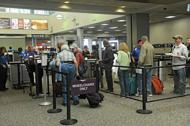 People wait to to go through the security check point area to get to their gates at the Albany International Airport on Wednesday, Sept. 24, 2014 in Colonie, N.Y. (Lori Van Buren / Times Union) Photo: Lori Van Buren / 10028742A