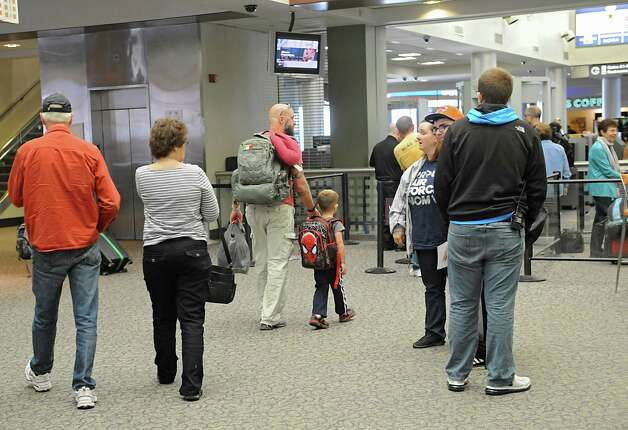 People get in line at the security check point area to get to their gates at the Albany International Airport on Wednesday, Sept. 24, 2014 in Colonie, N.Y. (Lori Van Buren / Times Union) Photo: Lori Van Buren / 10028742A