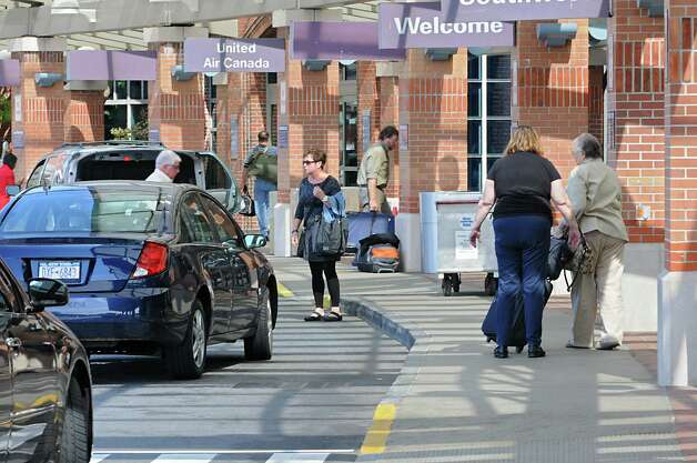 People get dropped off at the curb of the terminal at the Albany International Airport on Wednesday, Sept. 24, 2014 in Colonie, N.Y. (Lori Van Buren / Times Union) Photo: Lori Van Buren / 10028742A
