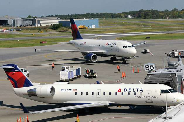Delta airplanes are seen from the observation deck at the Albany International Airport on Wednesday, Sept. 24, 2014 in Colonie, N.Y. (Lori Van Buren / Times Union) Photo: Lori Van Buren / 10028742A