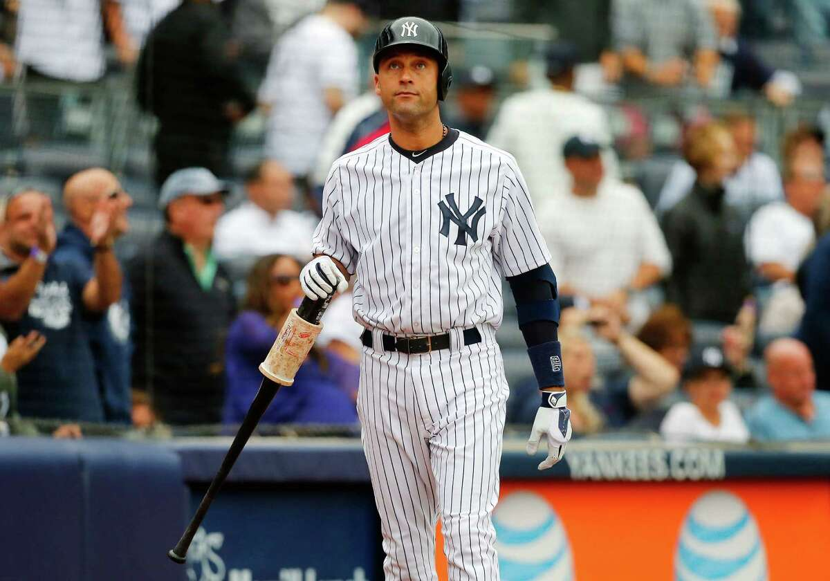 NEW YORK, NY - SEPTEMBER 24: Derek Jeter #2 of the New York Yankees looks on after he was left on deck during the final out of a game against the Baltimore Orioles at Yankee Stadium on September 24, 2014 in the Bronx borough of New York City. (Photo by Jim McIsaac/Getty Images) ORG XMIT: 477590527