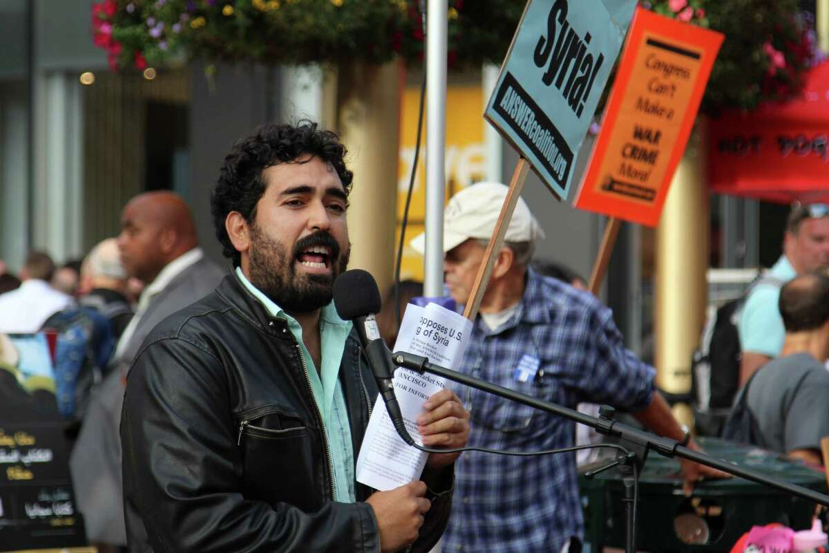 Frank Lara, an organizer with the ANSWER Coalition, rallies protesters at an anti-war demonstration in downtown San Francisco on Wednesday.