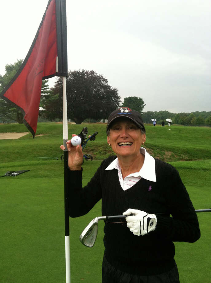 Alison Tane celebrates a hole-in-one on the eighth hole at Longshore during the Longshire Women's Golf Association event on Tuesday. Tane hit a 7-iron on the 123-yard hole. Photo: Contributed Photo / Westport News Contributed