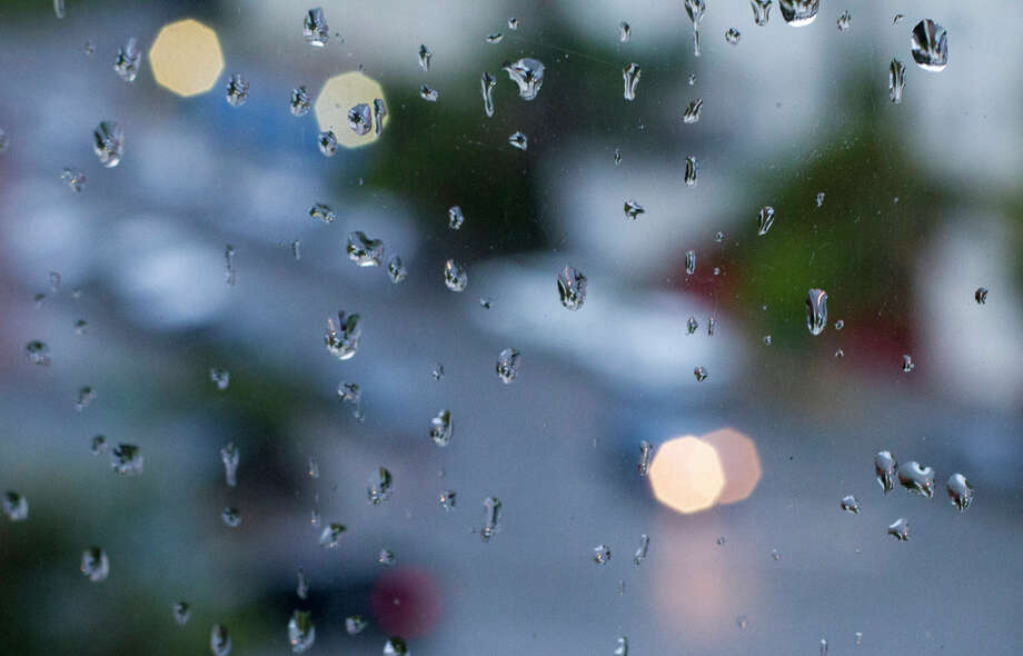 Rain slickened windows and streets throughout the Bay Area on Sept. 25th with the season's first significant rainfall. Photo: SF Gate / Douglas Zimmerman