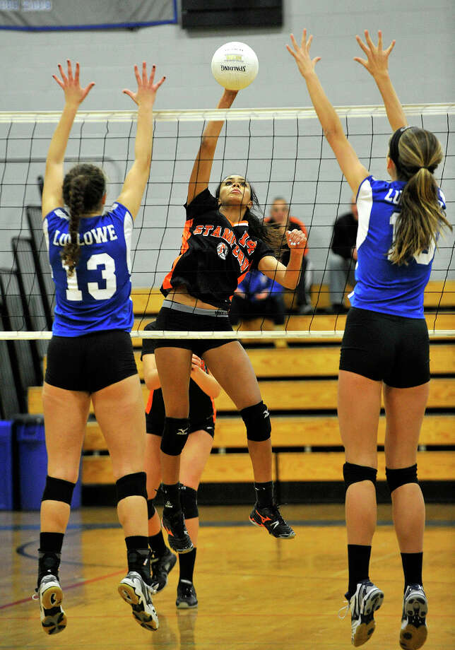 Ludlowe's Keki Cardenas, left, and April Cooke, in action last year against Stamford, are two reasons why the Falcons are flying high. Photo: Jason Rearick / Stamford Advocate