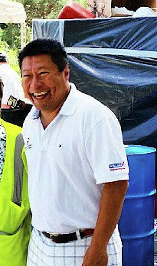 State Rep. Tony Hwang, R-134, in a photo from his campaign website wearing one of the polo shirts with his campaign logo. This clothing is the basis of an elections complaint filed by the Democratic Town Committe. Photo: Contributed Photo /  Fairfield Citizen contributed