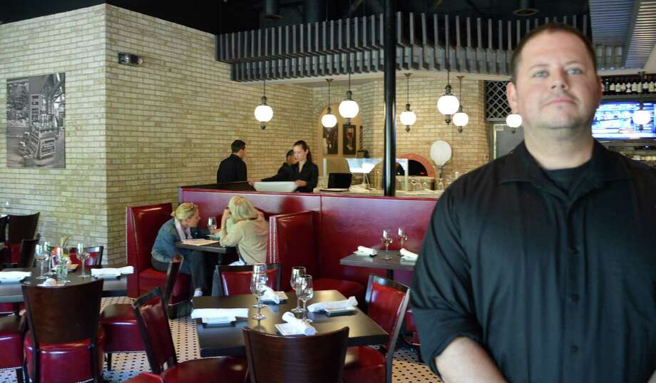 The new Pizzeria Bravo on Post Road East, according to manager Seth Kulback, pictured, is serving some of the best pizza in town. Photo: Jarret Liotta / Westport News