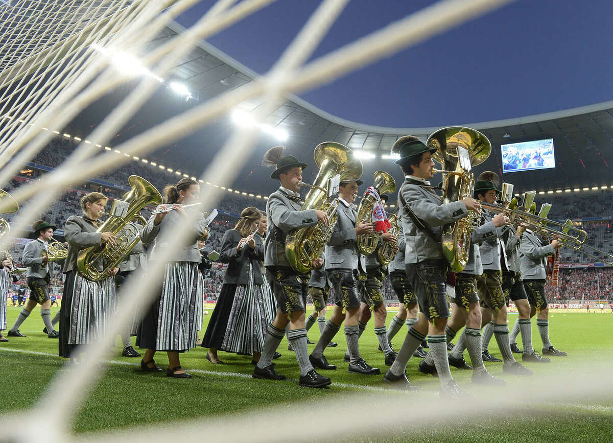 Members of a Bavarian brass band perform as part of the Oktoberfest prior to the German first division Bundesliga football match FC Bayern Munich vs SC Paderborn 07 in Munich, southern Germany on September 23, 2014.