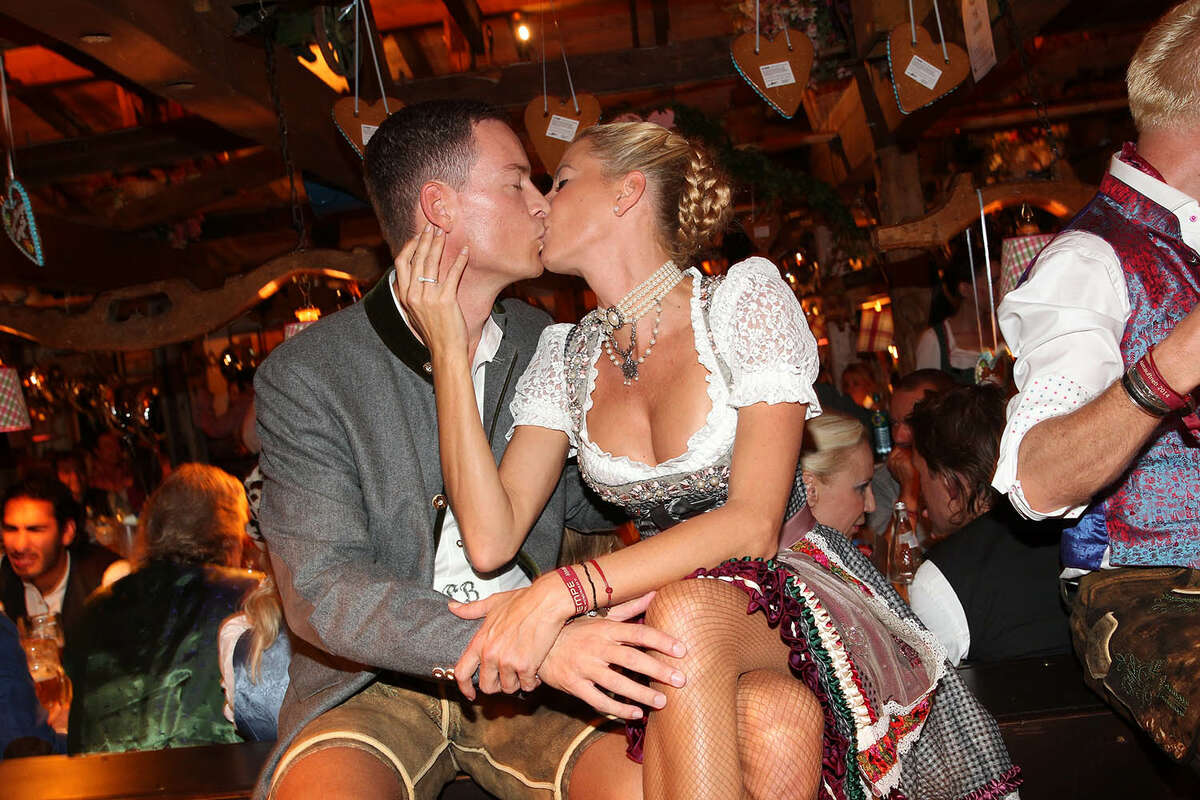 Giulia Siegel and her boyfriend Frank Buechtmann attend the 'Almauftrieb' at Kaefer tent during Oktoberfest at Theresienwiese on September 21, 2014 in Munich, Germany.