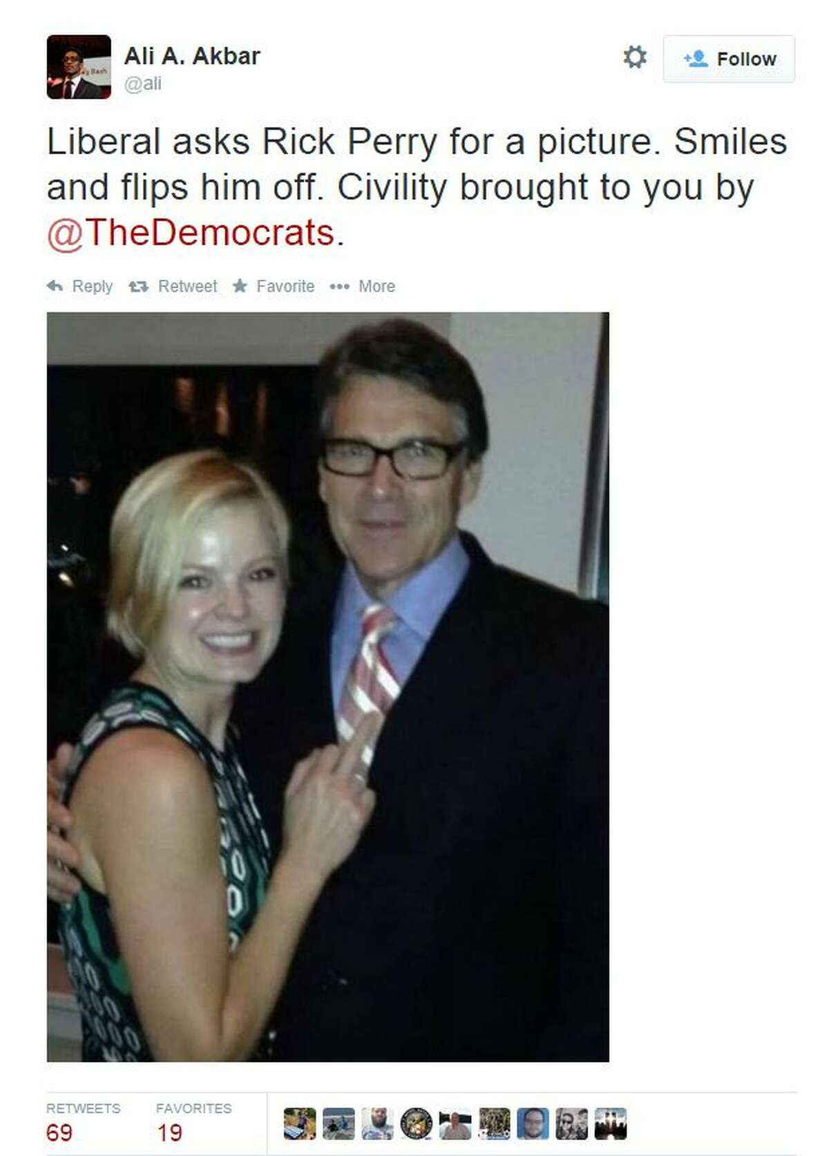 A photo of Gov. Rick Perry posing with a woman making a lewd gesture could have been prodded by alcohol. The woman in the photo - identified only as