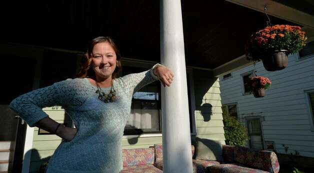 Alison Szczawinski stands on the front porch of her home on Rose Court Wednesday morning Sept. 24, 2014 in Albany, N.Y.   (Skip Dickstein/Times Union) Photo: SKIP DICKSTEIN / 00028692A