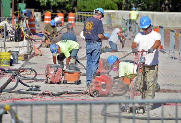 Crews work on the walkways on the Empire State Plaza Wednesday Sept. 24, 2014, in Albany, NY.  (John Carl D'Annibale / Times Union) Photo: John Carl D'Annibale, Albany Times Union