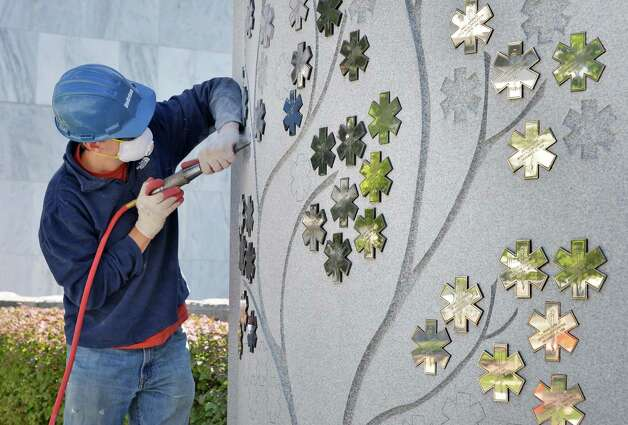 Stone carver Chris Pellettieri works on the EMS Memorial on the Empire State Plaza Wednesday Sept. 24, 2014, in Albany, NY.  (John Carl D'Annibale / Times Union) Photo: John Carl D'Annibale, Albany Times Union