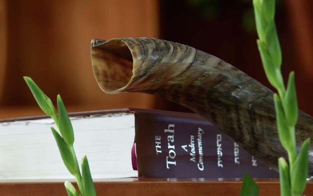 The shofar, or rams horn, and the Torah which will be used Wednesday night, Sept. 23, 2014, to celebrate Rosh Hashanah, the Jewish New Year, at Temple Beth Emeth in Albany, N.Y. (Skip Dickstein/Times Union) Photo: SKIP DICKSTEIN, ALBANY TIMES UNION / 00028745A
