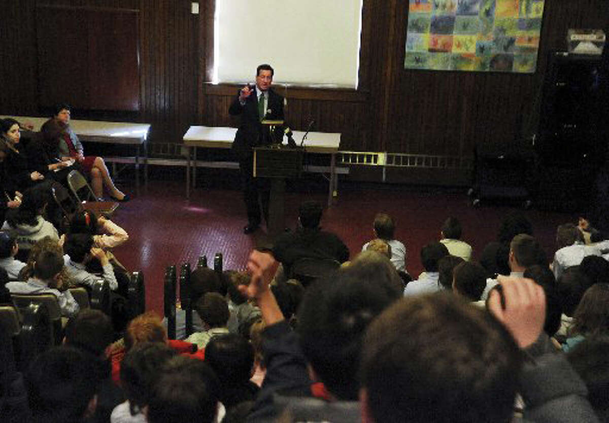 Gov. Dan Malloy speaks about his struggles in school to a group of students and teachers at Eagle Hill School in Greenwich, on March 29, 2011.
