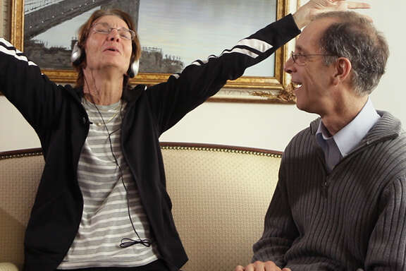 """Dan Cohen watches as a nursing-home resident reacts to music in """"Alive Inside."""""""