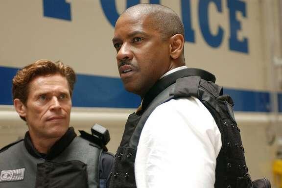 """Willem Dafoe, left, and Denzel Washington star in """"Inside Man."""""""