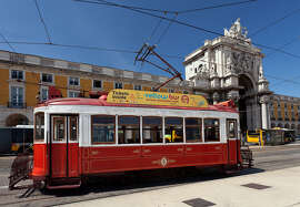 Trolleys are a great way to tour Lisbon, but don't hang your head out the window because they pass within inches from parked cars.