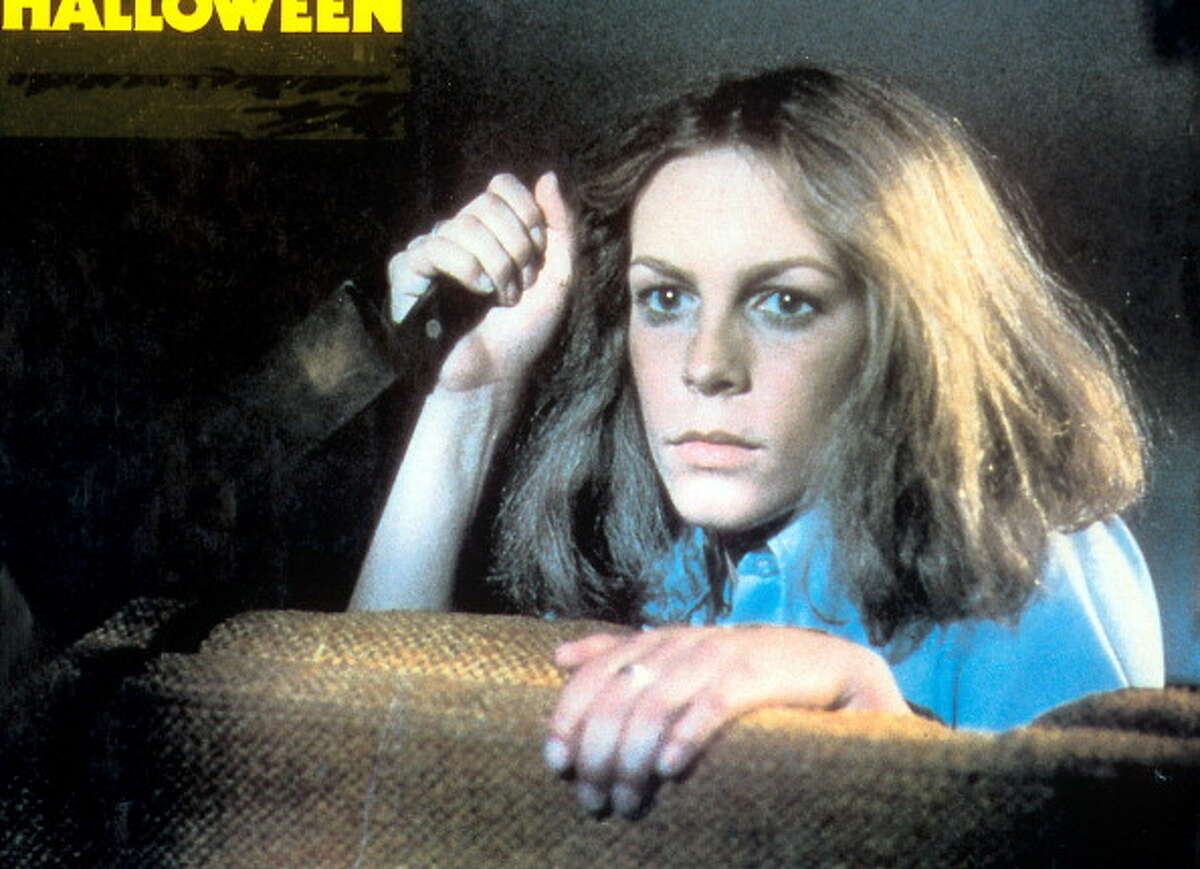 Jamie Lee Curtis holds a knife in a scene from the film 'Halloween', 1978.