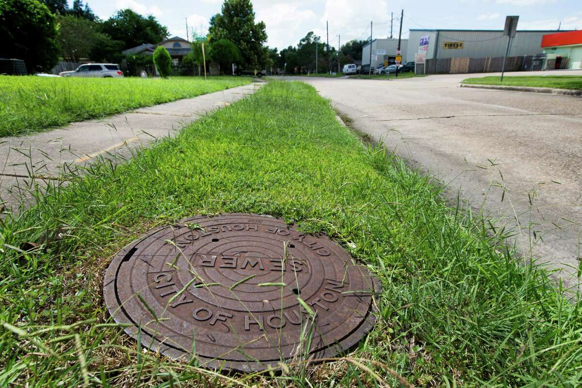 A City of Houston manhole cover is shown in the Mission Bend area on Wednesday, Sept. 10, 2014, in Houston.
