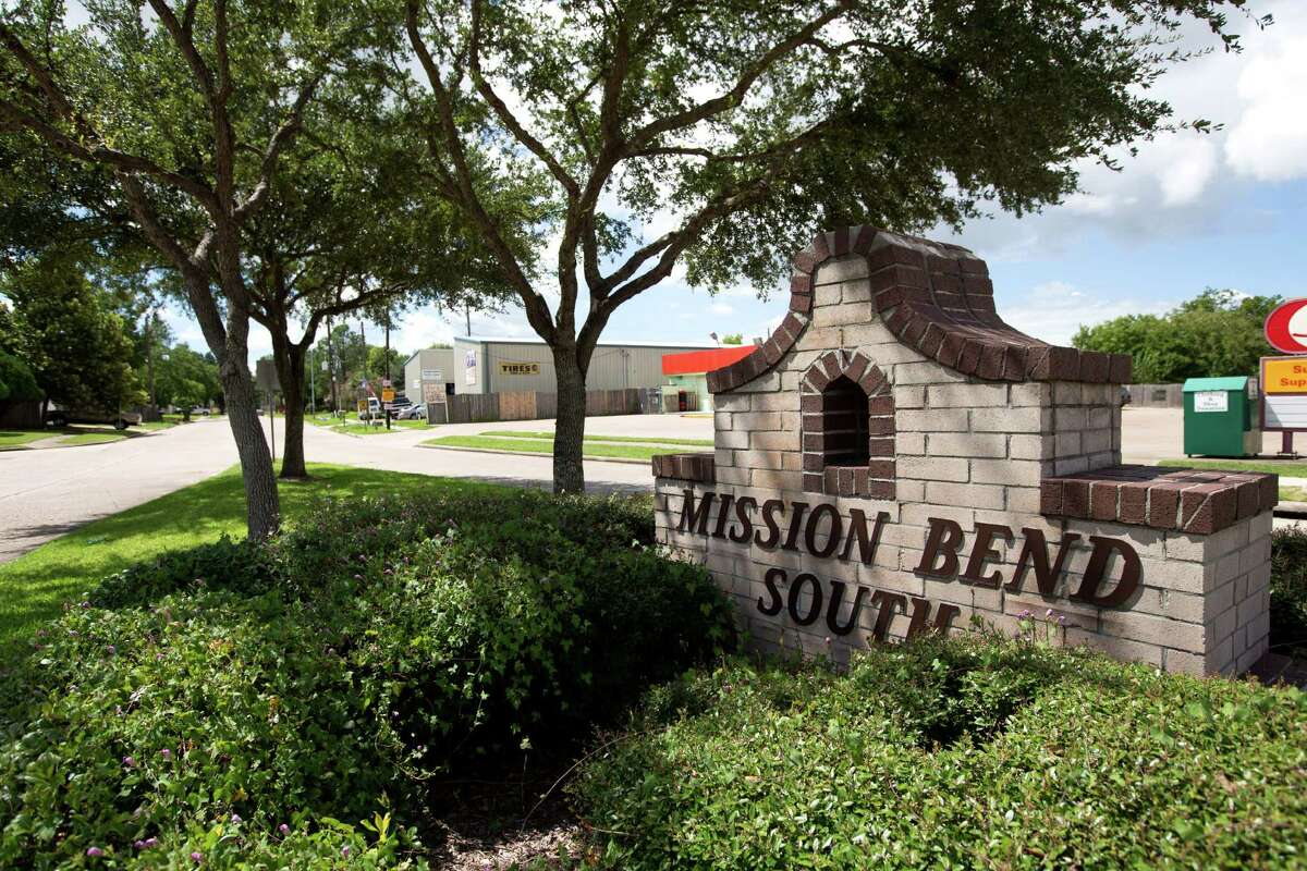 A sign for the Mission Bend South subdivision is shown near a residential area across the street from various businesses on Wednesday, Sept. 10, 2014, in Houston.