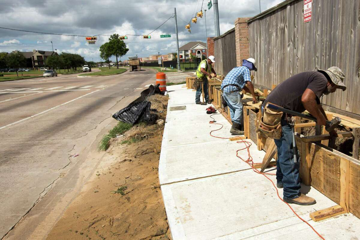 A sidewalk is constructed along Westpark Drive in the Mission Bend area on Wednesday, Sept. 10, 2014, in Houston.