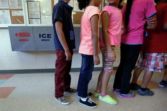 Children line up for a meal at the Karnes County Residential Center, a temporary home in Texas for immigrant women with kids detained at the border.
