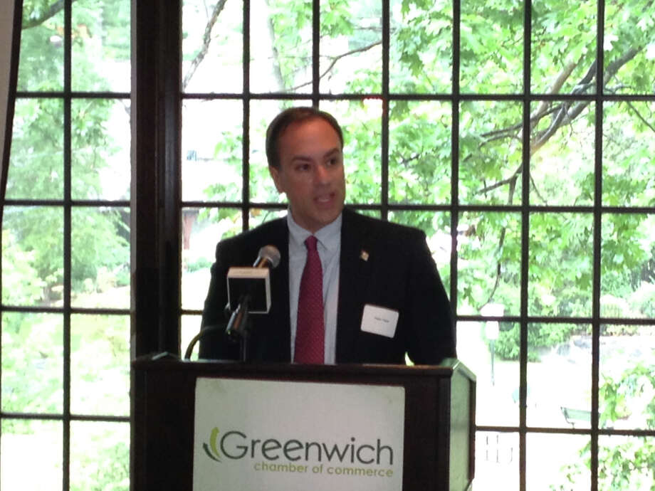 First Selectman Peter Tesei delivers his State of the Town address at the Milbrook Club Thursday. Photo: Robert Marchant / Greenwich Time