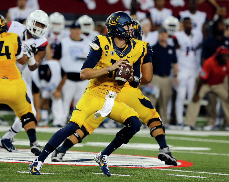 Cal quarterback Jared Goff is throwing for 136 fewer yards per game than he averaged in his first three games last season, but with two wins has already doubled 2013's total. Photo: Rick Scuteri / Associated Press / FR157181 AP