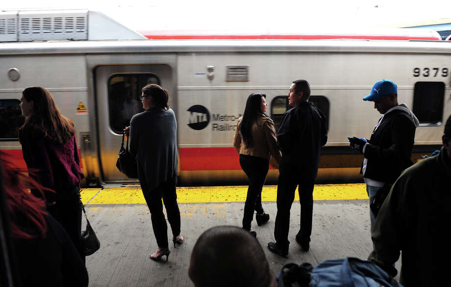 Commuters and travelers wait for a Metro-North train to stop at the Bridgeport train station on Water Street in Bridgeport, Conn., on Thursday Sept. 25, 2014. Security at train stations have been enhanced after a report of a terror plot against stations in NYC was released. Photo: Christian Abraham / Connecticut Post