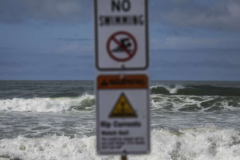 In this file photo, a no swimming sign at Ocean Beach on September 25th 2014.  Photo: Sam Wolson, Special To The Chronicle