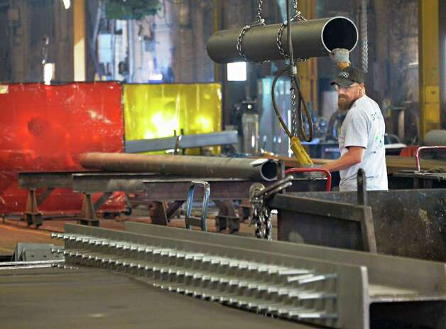 Layout/fitter Bill Egan uses a 15 ton crane to move material at STS Steel Friday Sept. 19, 2014, in Schenectady, NY.   (John Carl D'Annibale / Times Union) Photo: John Carl D'Annibale / 00028680A