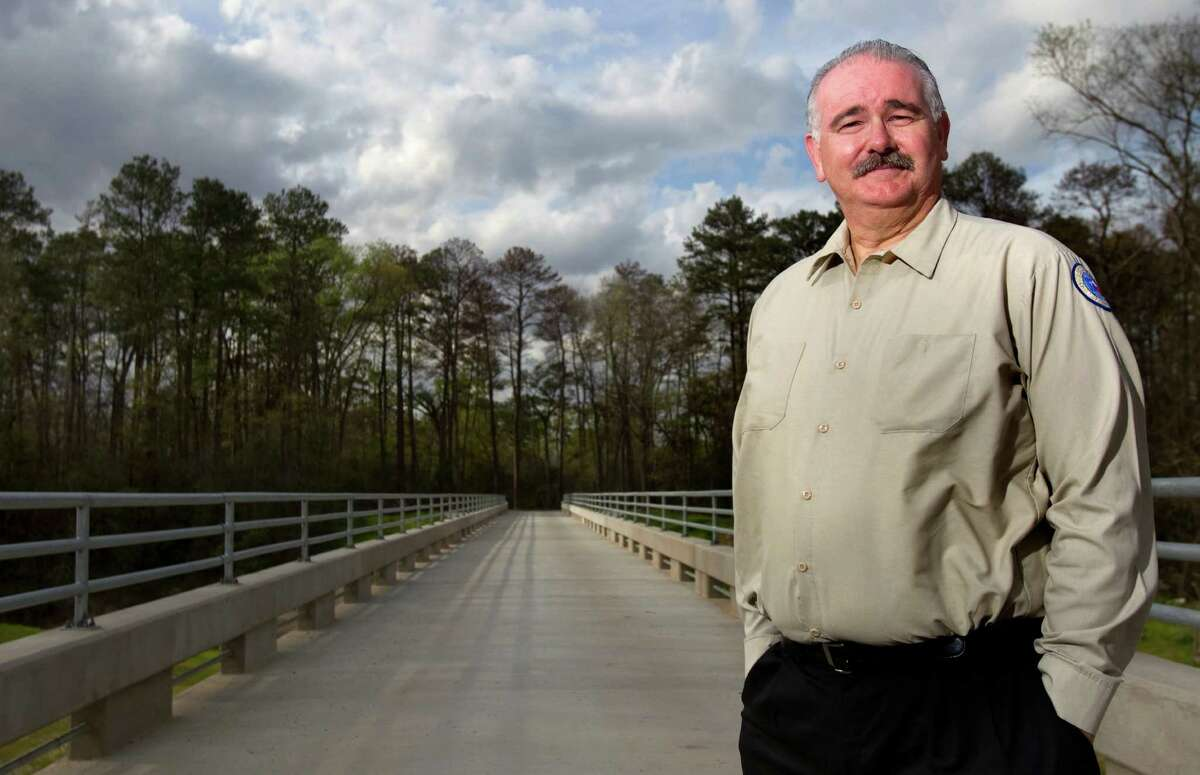 Harris County Precinct 4 Commissioner Jack Cagle stands on the Spring Creek Greenway trail Tuesday, March 6, 2012, in Humble. The linear park system developed by Harris and Montgomery counties will stretch more than 30 miles when it's all done. (Cody Duty / Houston Chronicle)