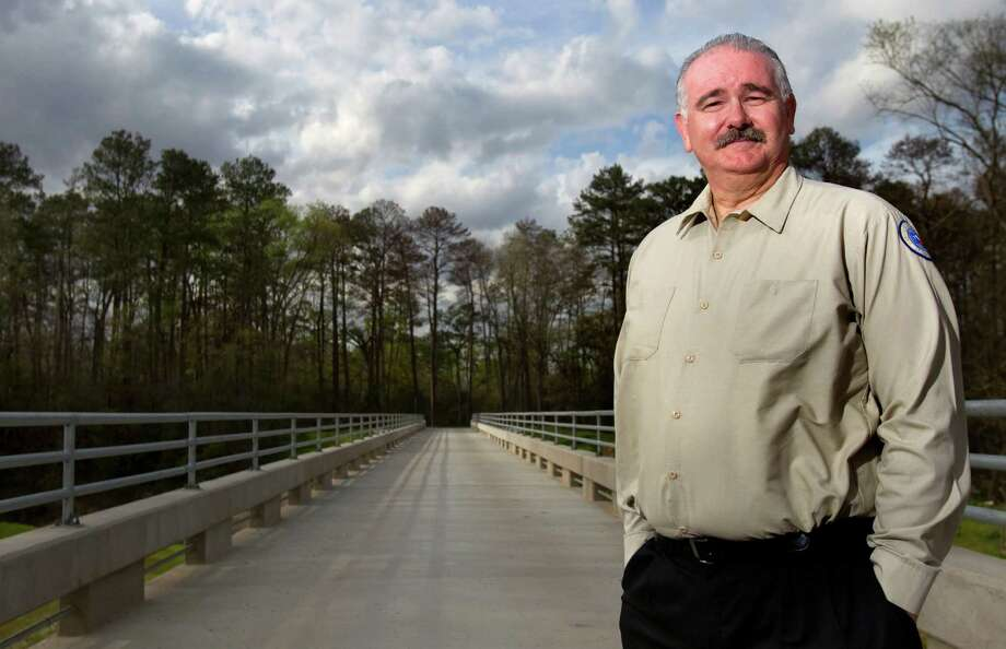 Harris County Precinct 4 Commissioner Jack Cagle stands on the Spring Creek Greenway trail Tuesday, March 6, 2012, in Humble. The linear park system developed by Harris and Montgomery counties will stretch more than 30 miles when it's all done. (Cody Duty / Houston Chronicle) Photo: Cody Duty, Staff / © 2011 Houston Chronicle