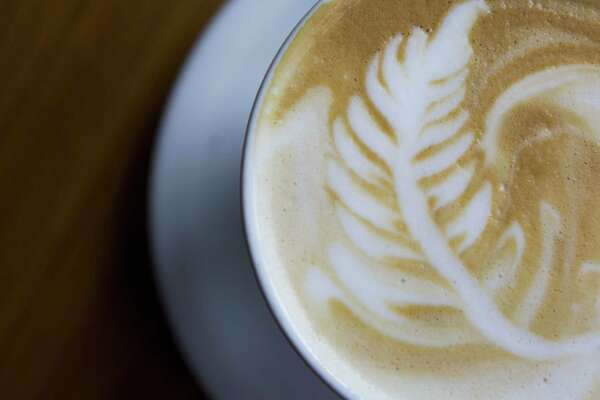 Rosella Coffee's latte. The coffee shop has become a downtown favorite.  Citywide, shops are roasting, brewing and serving coffees from around the world.