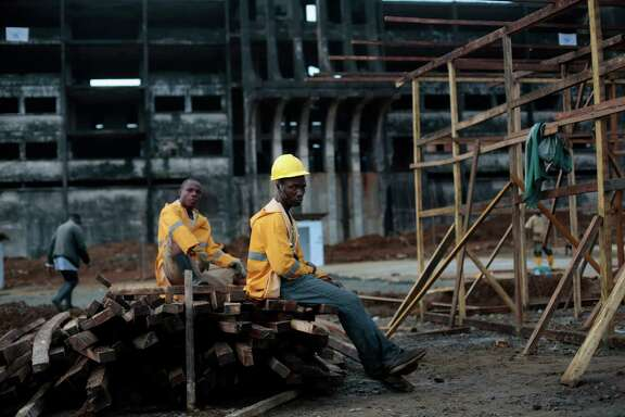 Workers take a break Thursday while building an Ebola isolation and treatment center in Monrovia, Liberia.  The center is due to open within two weeks.