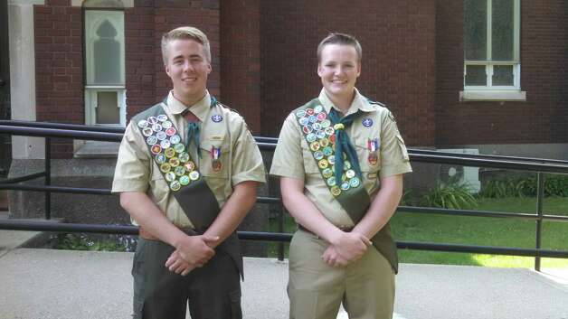 Brendan Costello and Gunnar Schifley of Cohoes received their Eagle Scout designation last month in Cohoes. Friends, family and troop leaders attended, including their parents Ann-Marie and Kevin Costello and Michelle and Stephen Schifley. Both scouts are 2014 graduates of Catholic Central High School in Troy and members of Troop 670 of the Twin Rivers Council. Costello beautified the main dining area of the Cohoes Senior Center. Schifley worked with the city of Cohoes and Daughters of the American Revolution to create a park stop on a walking path in front of the VanSchaick Mansion Cemetery. (Submitted photo)