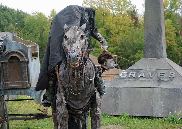 A headless horseman is part of the scenery for the Halloween season at Capital Combat Zone and The Field of Horrors on Thursday, Sept. 25, 2014 in Brunswick, N.Y. (Lori Van Buren / Times Union) Photo: Lori Van Buren / 00028765A