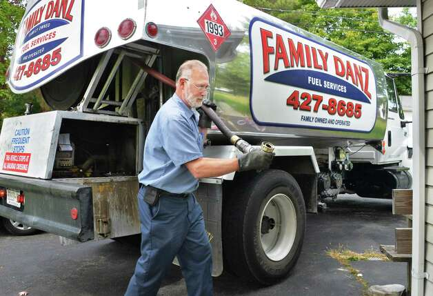 Heating oil delivery driver Glenn Hotaling of Family Danz Heating and Cooling delivers heating oil to a home Thursday Sept. 25, 2014, in Castleton, NY.  (John Carl D'Annibale / Times Union) Photo: John Carl D'Annibale / 00028770A