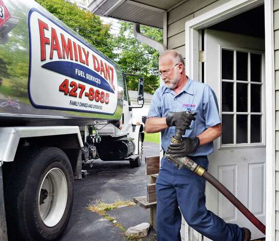 Heating oil delivery driver Glenn Hotaling of Family Danz Heating and Cooling finishes up a delivery of heating oil to a home Thursday Sept. 25, 2014, in Castleton, NY.  (John Carl D'Annibale / Times Union) Photo: John Carl D'Annibale / 00028770A