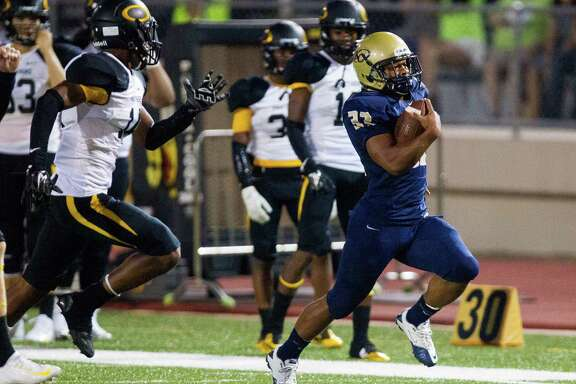 Klein Collins running back Justin Pratt, right, leaves behind a host of Klein Oak defenders as he scampers for a 52-yard gain in the first half of Thursday's game.
