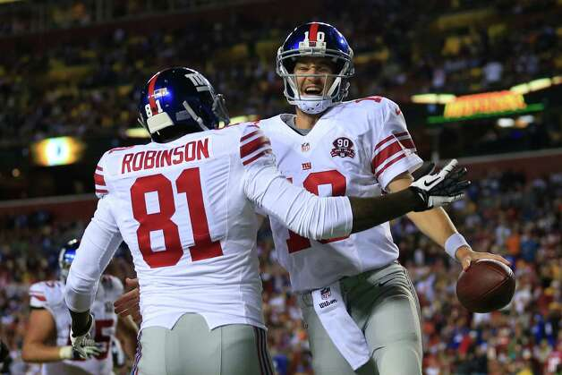 LANDOVER, MD - SEPTEMBER 25: Quarterback Eli Manning #10 of the New York Giants celebrates his 4th quarter touchdown against the Washington Redskins at FedExField on September 25, 2014 in Landover, Maryland. (Photo by Rob Carr/Getty Images) ORG XMIT: 504251933 Photo: Rob Carr / 2014 Getty Images