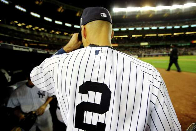 NEW YORK, NY - SEPTEMBER 25:  Derek Jeter #2 of the New York Yankees looks on from the dugout against the Baltimore Orioles in his last game ever at Yankee Stadium on September 25, 2014 in the Bronx borough of New York City.  (Photo by Al Bello/Getty Images) ORG XMIT: 477590579 Photo: Al Bello / 2014 Getty Images